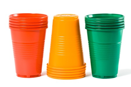 Multi-coloured disposable plastic glasses isolated on white background photo