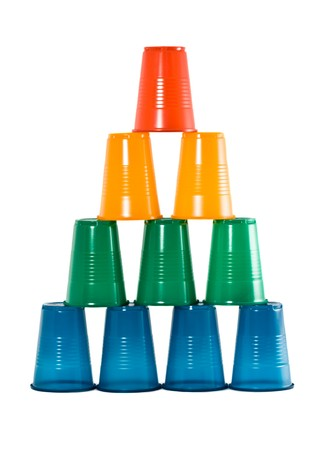 Pyramid from multi-coloured disposable plastic glasses isolated on white background photo