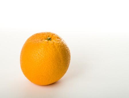 gustatory: Single sweet orange fruit  on gray background