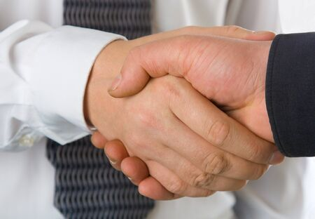 A business handshake. Isolated on white background Stock Photo - 4133771