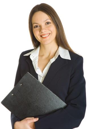 Une belle femme d'affaires, la tenue d'une presse-papiers. Isolé sur fond blanc