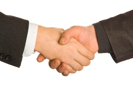 A business handshake. Isolated on white background Stock Photo - 4133773