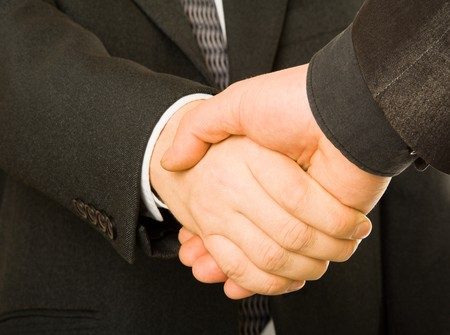 mani che si stringono: Un business handshake. Isolated on white background Archivio Fotografico