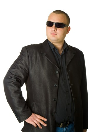 Man in black suit in sun glasses. Isolated on white background photo