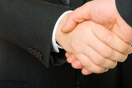 A business handshake of two businessman in black suits Stock Photo - 4214980
