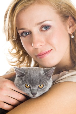 Young beautiful woman and kitten. Isolated on white background photo