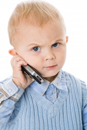 angry child: Concept of little businessman. Child speak on the phone. Isolated on white background