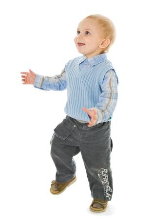 toddler walking: Walking little boy. Isolated on white background Stock Photo