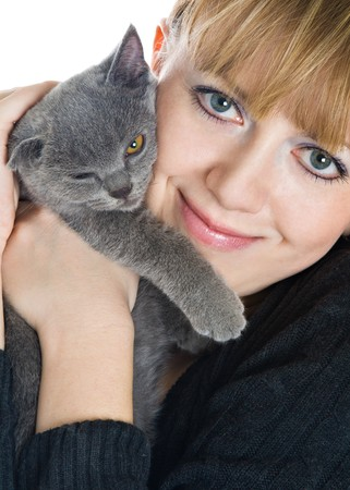 The young beautiful woman and kitten. Isolated on white background photo