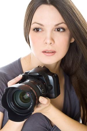 Portret van een mooie jonge vrouw met camera. Geïsoleerd op witte achtergrond Stockfoto