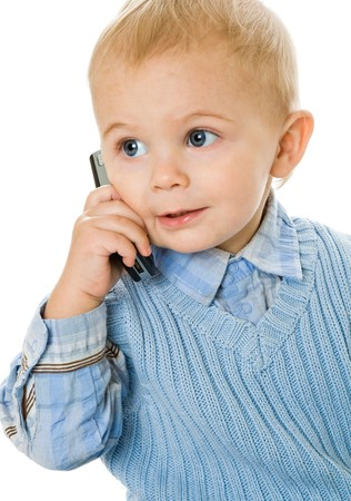 Concept of little businessman. Child speak on the phone. Isolated on white background photo