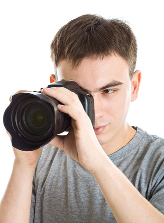 Young photographer with camera. Isolated on white background Stock Photo - 4540840