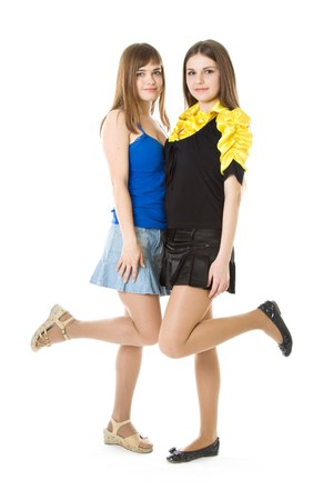 falda corta: Dos ni�as con la pierna planteadas aislados en el fondo blanco Foto de archivo