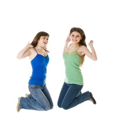 Two jumping girls. Isolated on white background Stock Photo - 4569573