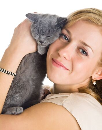 Young beautiful woman and little kitten. Isolated on white background photo