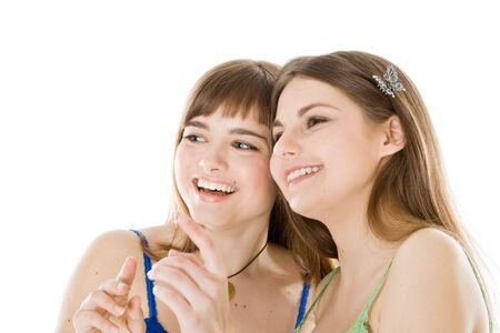 Two teenage girls looking up. Isolated on white background photo