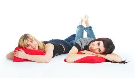 Two beautiful lying girls. Isolated on white background photo