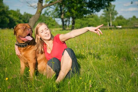 french mastiff: Young girl and her dog (French mastiff, Dogue de Bordeaux)