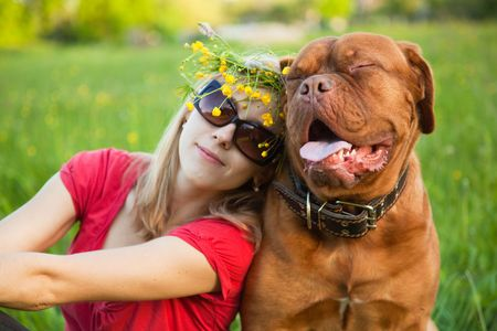 mastiff: Young girl and her dog (French mastiff, Dogue de Bordeaux)