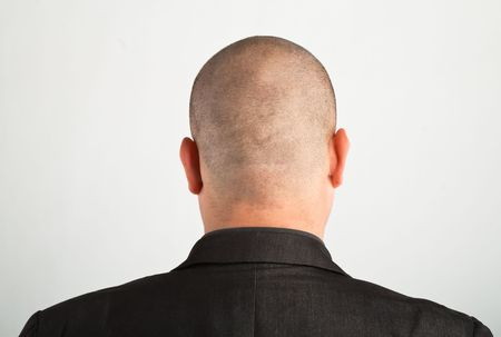 'head and shoulders': Back of male head.