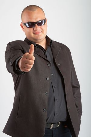 Man in black suit in sun glasses.  photo