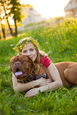 females only: Young girl and her dog (French mastiff, Dogue de Bordeaux)