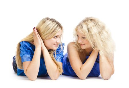 Two young girlfriends. Isolated on white background Stock Photo - 5184201