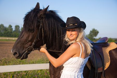 cute young farm girl: Young blond woman with horse