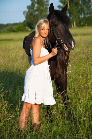 Young  blond woman with horse photo