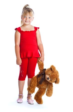 Girl with teddy-bear. Isolated on white background photo