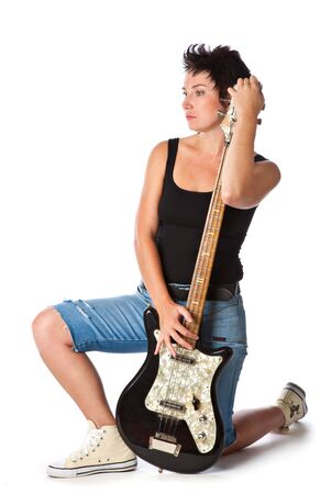 Woman with electric guitar. Isolated on white background photo