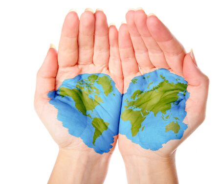 Map of world painted on hands. Isolated on white background photo