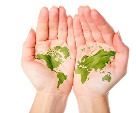 green world: Map of world painted on hands. Isolated on white background
