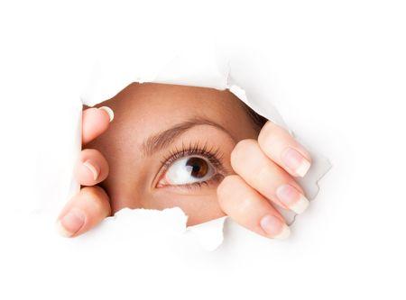 Eye looking through hole. Isolated on white background