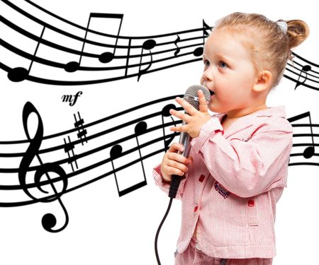 child singing: Little girl with microphone on background with notes
