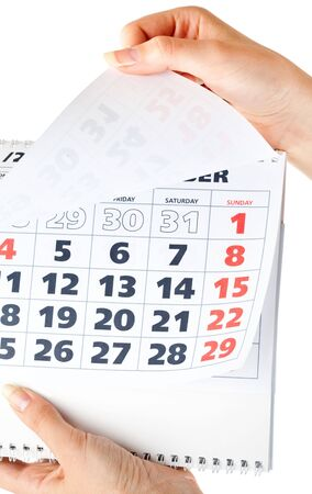 almanac: Close up of calendar in hands. Isolated on white background