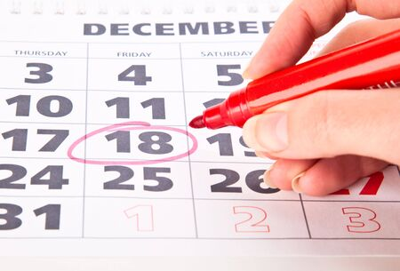 personal organiser: Red circle marked date on a calendar Stock Photo