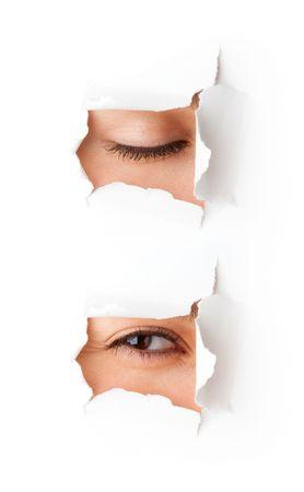 Eye looking through hole. Isolated on white background Stock Photo - 5883918