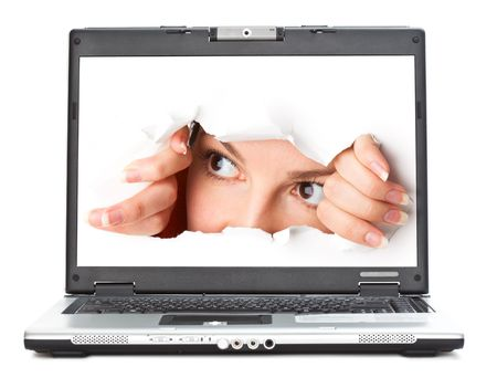 spies: Eye looking through hole in screen of laptop. Isolated on white background