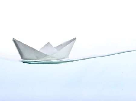 reverberation: Origami boat on water. Isolated on white background