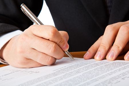 sign contract: Close up on a businessman hands signing a contract. Isolated on white background Stock Photo