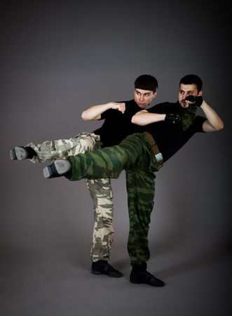 Two fighting man on gray background photo