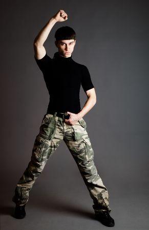 Man in uniform on gray background photo