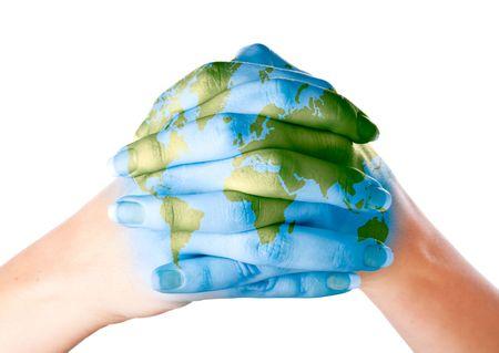 Kaart van de wereld geschilderd op handen. Geïsoleerd op witte achtergrond