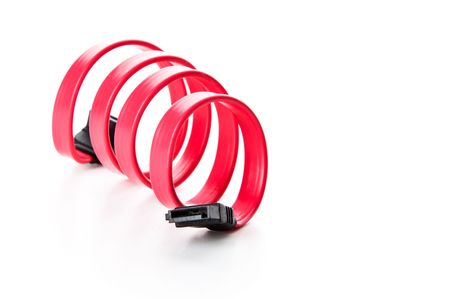ata: Red SATA cable twisted in spring. Isolated on a white background