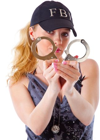 Blond woman with handcuffs. Isolated on white background Stock Photo - 6185766