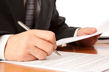 legal document: Close up on a businessman hands signing a contract. Isolated on white background Stock Photo