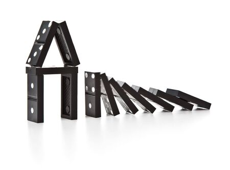 cause and effect: Stack of dominoes falling. Isolated on a white background