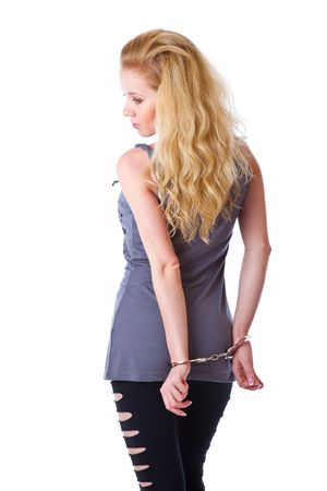 Blond woman with handcuffs. Isolated on white background photo