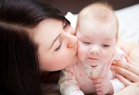 Adorable baby and mother in home Stock Photo - 6462648